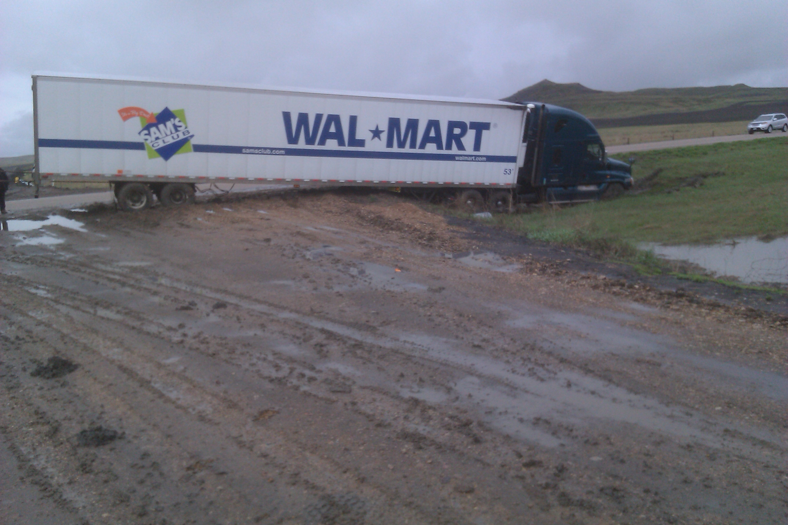 This semi loaded with food needed help getting back between the lines west of Alzada.