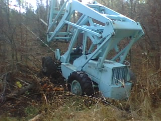 A run away forklift down a steep bank and a driver who jumped from the machine allowed this forklift to free wheel to the bottom of a draw in mud 150 yards down.