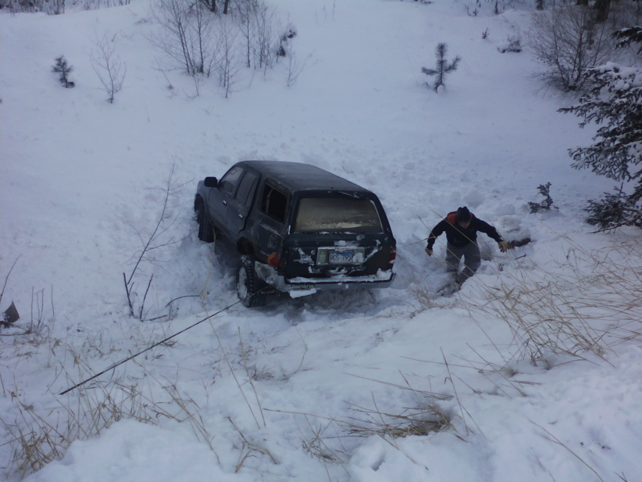 Slippery roads left this vehicle down a steep bank about 70 feet.